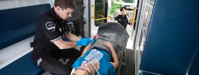 EMTs working on patient inside of an ambulance
