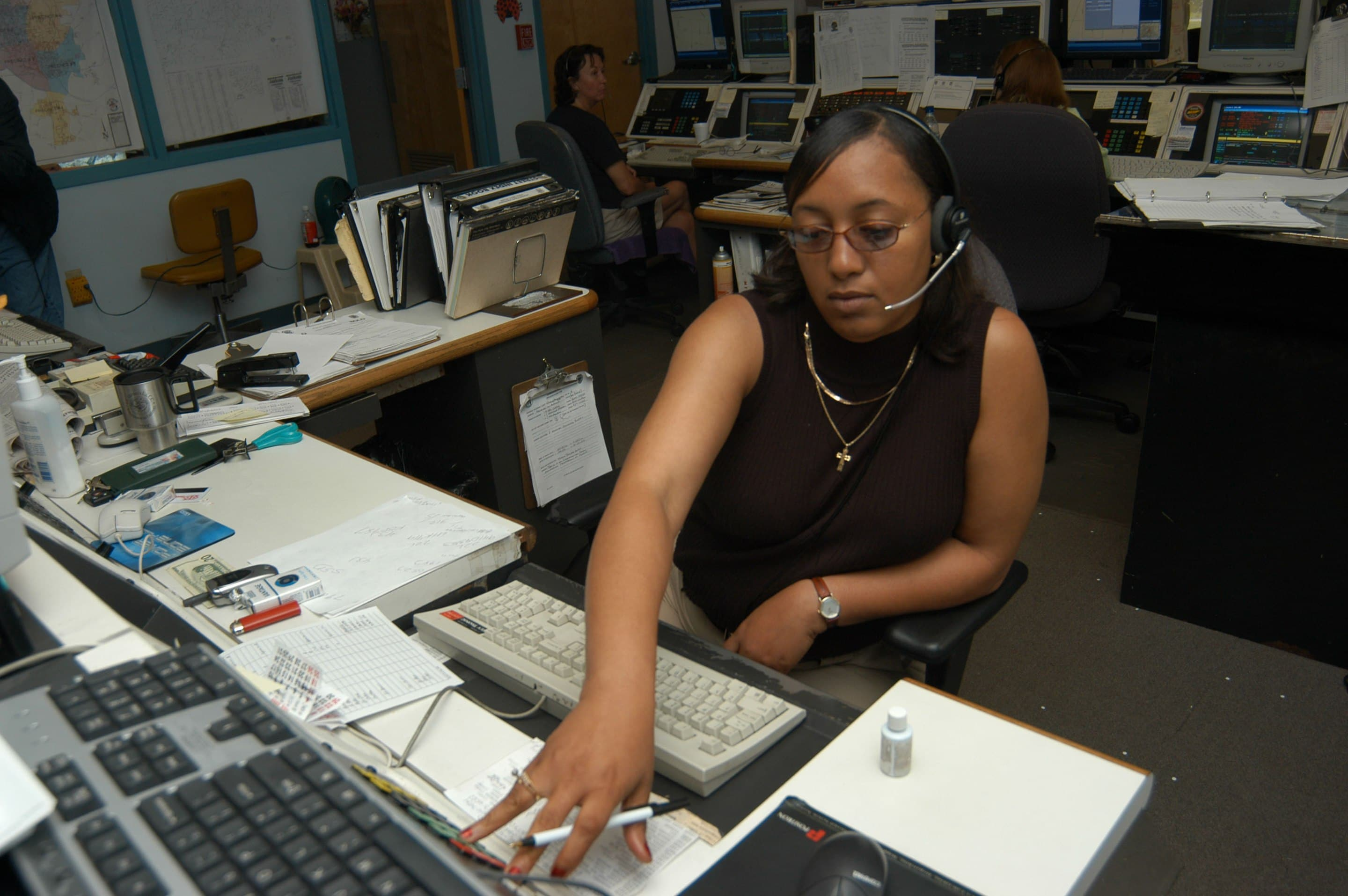Female dispatcher on a call