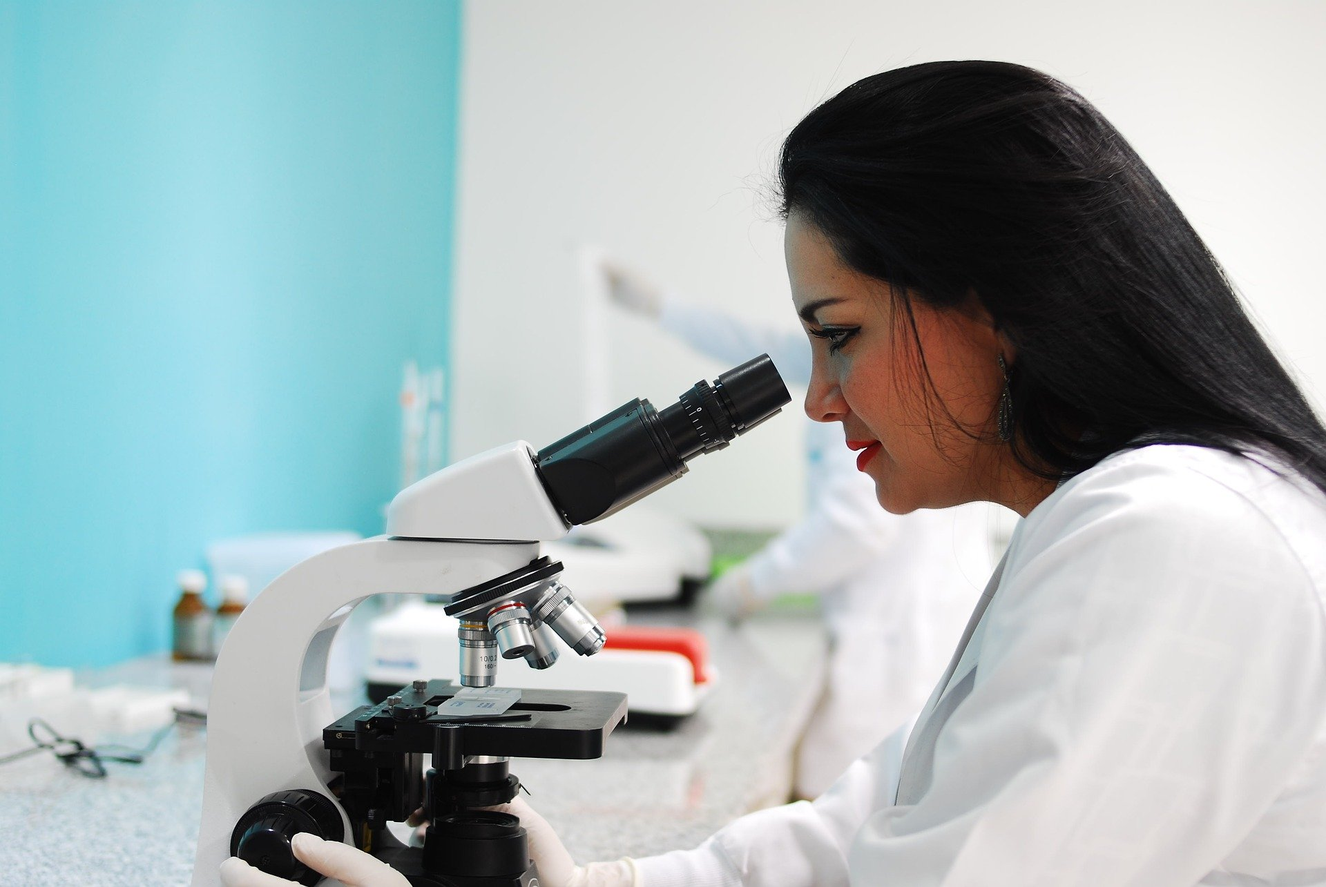 Female professional using a microscope