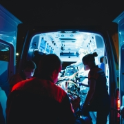 EMS team loading a patient into an ambulance