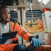 African-American paramedic with a patient