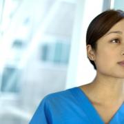 Female healthcare worker looking away