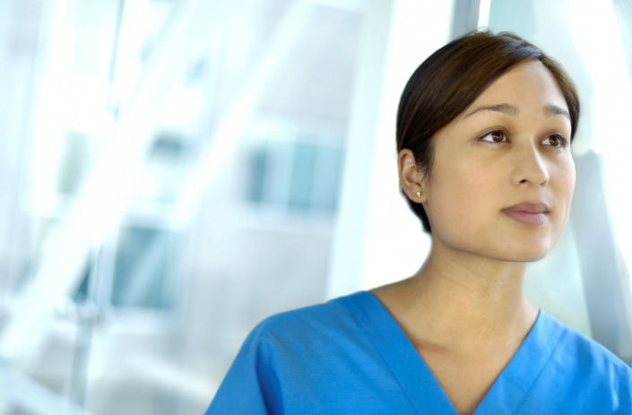 Female healthcare worker looking away