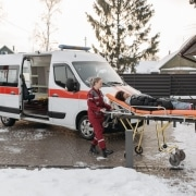 Paramedics transporting a patient in the snow