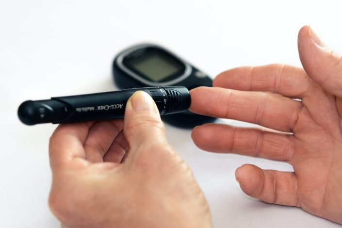 Diabetic person testing their blood sugar levels