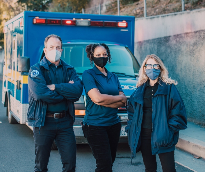 EMS professionals in front of an ambulance